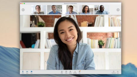 Woman smiling on a screen share meeting.