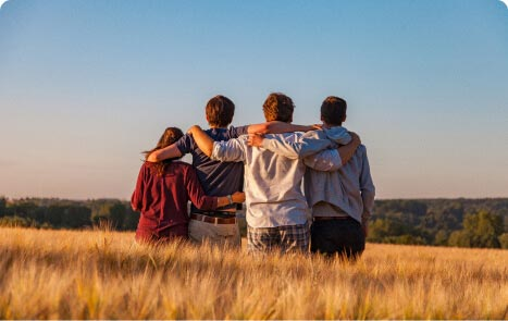 group of people embracing in a field